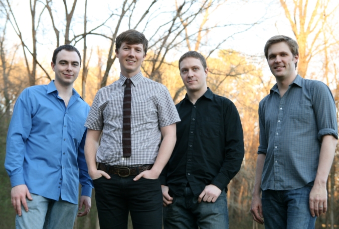 Brian Hart (second from left) pictured here with members of his band Bua.